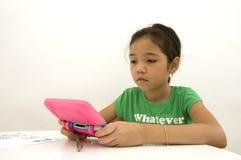 Asian Girl Playing Video Game Royalty Free Stock Image