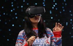 Asian Girl Playing Virtual Reality Dark Glow Snow Background.  royalty free stock photo