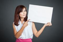 Asian girl point to blank sign Royalty Free Stock Photo