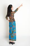Asian girl pointing Stock Photography