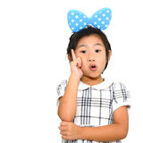 Asian girl pointing on white background Stock Images