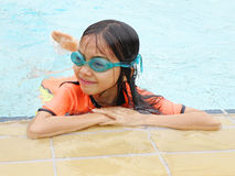 Asian girl in pool Royalty Free Stock Image