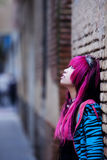 Asian girl portrait. Young thoughtful pink haired asian portrait Royalty Free Stock Photos