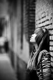 Asian girl portrait. Young thoughtful  asian against urban wall Stock Photo