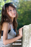 Asian girl portrait. A thai girl portrait with garden background Royalty Free Stock Images
