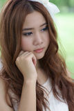 Asian girl portrait. A beautiful asian girl in park Royalty Free Stock Photography