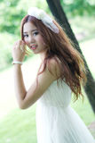 Asian girl portrait. A cute asian girl portrait in tropical park Stock Image