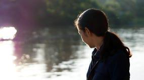 Asian girl potrait near river in morning sun Royalty Free Stock Photography