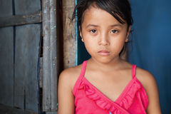 Asian girl in poverty. Portrait of a young girl from poverty-stricken area in Manila, the Philippines Stock Photos