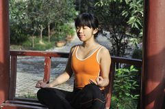 Asian girl practicing yoga Royalty Free Stock Photos