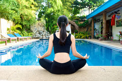 Asian Girl practicing yoga Stock Photo
