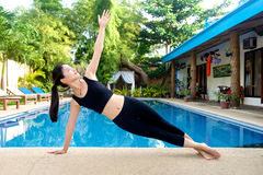 Asian Girl practicing yoga Royalty Free Stock Images