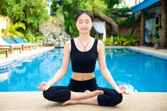 Asian Girl practicing yoga meditation Royalty Free Stock Photos