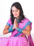 Asian girl in praying posture Royalty Free Stock Photography