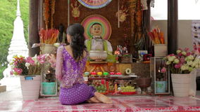 Asian girl praying in temple, wat, pagoda, Phnom Penh, Cambodia Stock Photography