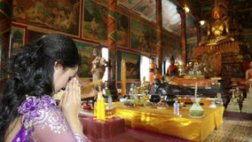 Asian girl praying in temple, wat, pagoda, Phnom Penh, Cambodia stock video footage