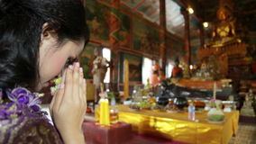 Asian girl praying in temple, wat, pagoda, Phnom Penh, Cambodia Stock Photos