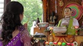 Asian girl praying in temple, wat, pagoda, Phnom Penh, Cambodia stock video