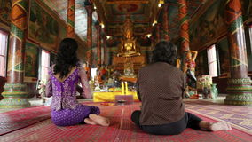 Asian girl praying in temple, wat, pagoda, Phnom Penh, Cambodia Royalty Free Stock Images