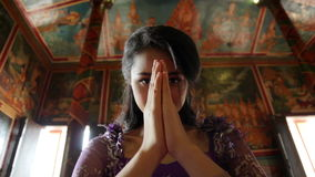Asian girl praying in temple, wat, pagoda, Phnom Penh, Cambodia Royalty Free Stock Image