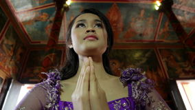 Asian girl praying in temple, wat, pagoda, Phnom Penh, Cambodia Stock Photo