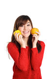 Asian girl pressing fruits and vegetable against her face Stock Photo