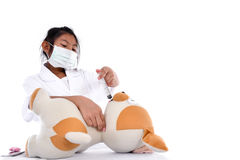 Asian girl pretending to be a doctor wearing healthy mask treame. Stock Image