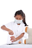 Asian girl pretending to be a doctor wearing healthy mask Royalty Free Stock Image