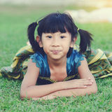 Asian girl in princess dress lying on grass Stock Photography