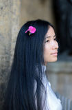 Asian girl profile with flower in her hairs Royalty Free Stock Photos