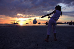 Asian girl pulling rope and mooring buoy. Royalty Free Stock Images