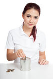 Asian girl put coin to money box Royalty Free Stock Photography