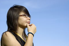 Asian girl pondering Royalty Free Stock Image