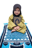 A Muslim Girl holding Quran Stock Image