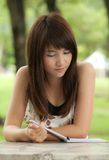 Asian Girl Reading Royalty Free Stock Photography