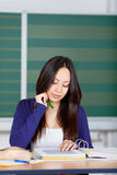 Asian girl reading in binder concentrated Stock Images