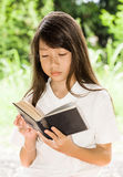 Asian girl reading book Stock Photography