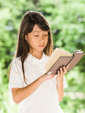 Asian girl reading book Stock Images
