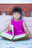 Asian girl reading a book. Education concept. Royalty Free Stock Images