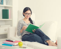 Asian girl reading book Royalty Free Stock Image