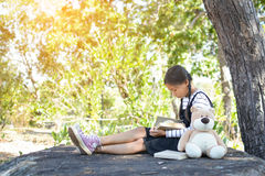 Asian girl reading a book on the park Stock Photography