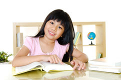 Asian girl reading Royalty Free Stock Image