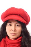 Asian girl in red cap. Long-haired Asian girl in red cap and scarf, isolated on white background Royalty Free Stock Photos