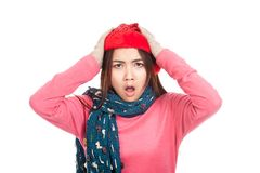 Asian girl with red christmas hat angry put hands on head Royalty Free Stock Photo