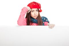 Asian girl with red christmas hat in bad mood with blank sign Stock Photos