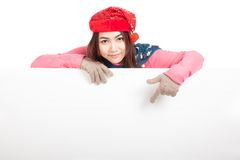 Asian girl with red christmas hat behind blank banner  point dow Royalty Free Stock Photo