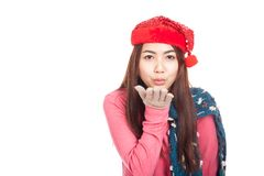 Asian girl with red christmas hat blowing a kiss Royalty Free Stock Photography
