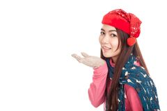 Asian girl with red christmas hat blowing a kiss and smile Stock Photography