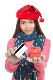 Asian girl with red christmas hat,credit card and gift box Stock Image