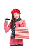 Asian girl with red christmas hat ,credit card and shopping bag. Isolated on white background Royalty Free Stock Image